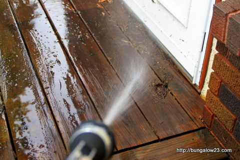 spraying debris off deck