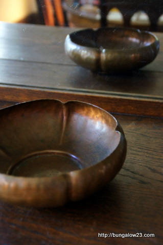 antique copper bowl in mirror