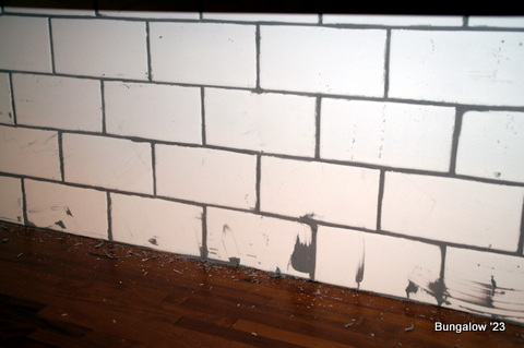 Kitchen Backsplash Uneven Wall subway tile backsplash installed